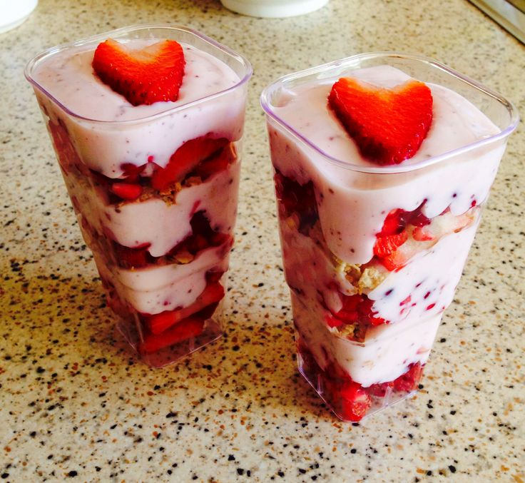 "Slimming world breakfast ""knickerbocker glories""  Layers of strawberry and pomegranate, raspberry mullerlight yoghurt with chocolate sprinkles and a little granola  Quick and easy"