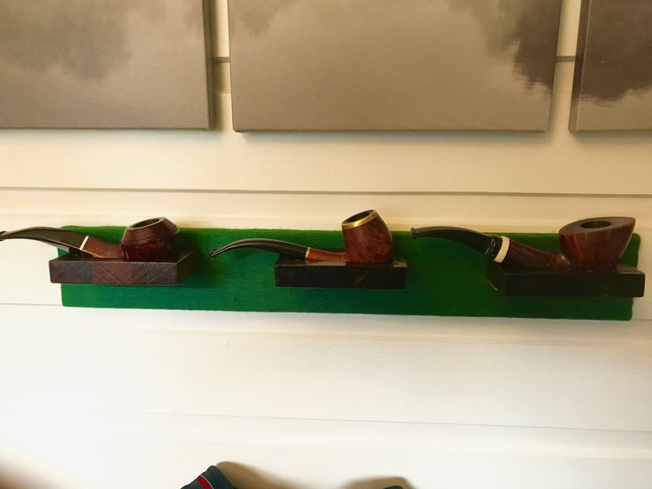 Three pipes or an pipeboard on the wall.