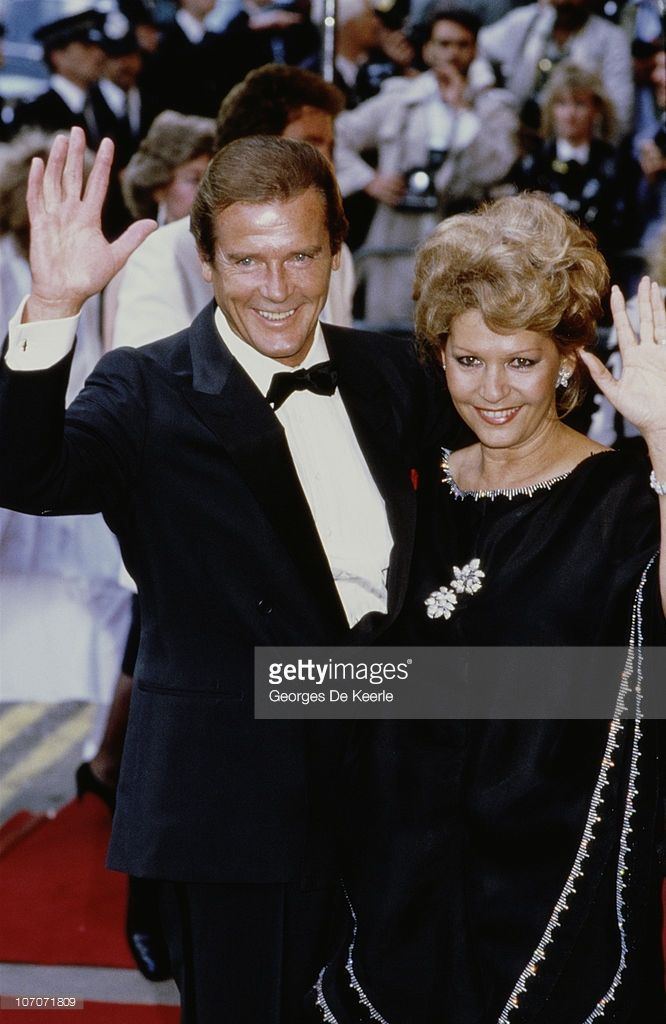Roger Moore with his wife Luisa Mattioli at the London premiere of the James Bond film 'A View to a Kill', 12th June 1985.