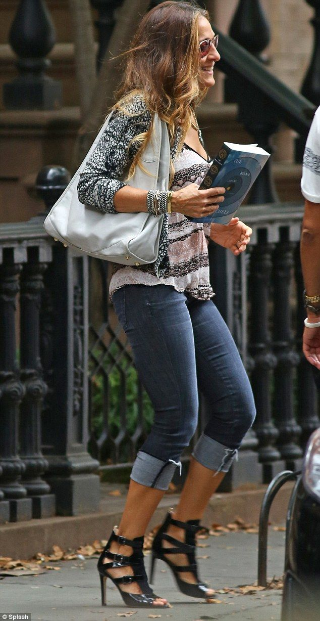 In the city: Sarah Jessica Parker headed out for the day from her New York home in statement black heels -- thanks for showing us how to wear something soft and flowey with such a kickass shoe!