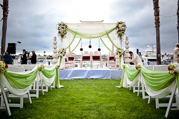 Outdoor Wedding Flower Ideas For A Beach Wedding: Green And White Drape Mandap On White Linen Covered Stage
