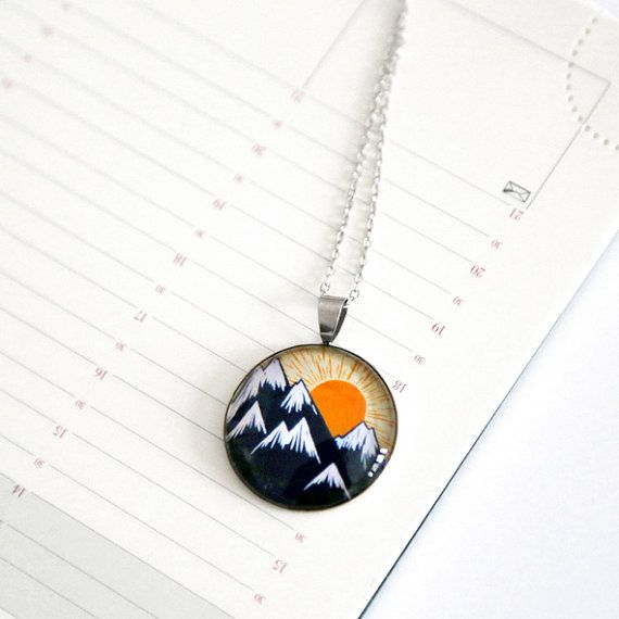 Silver pendant necklace with a linocut illustration by Yamok