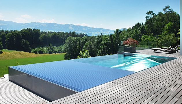 Espectacular piscina de inox desbordante y canal recogida for Construction piscine inox