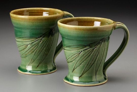 Willow leaf decorated mugs....like how this glaze shows off gently carved design