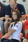 AUGUST 9 2012 - At the London 2012 aquatics centre with Prince Albert of Monaco to watch the women's synchronised swimming. She wore a wore a Team GB polo shirt, Zara jeans and LK Bennett wedges.
