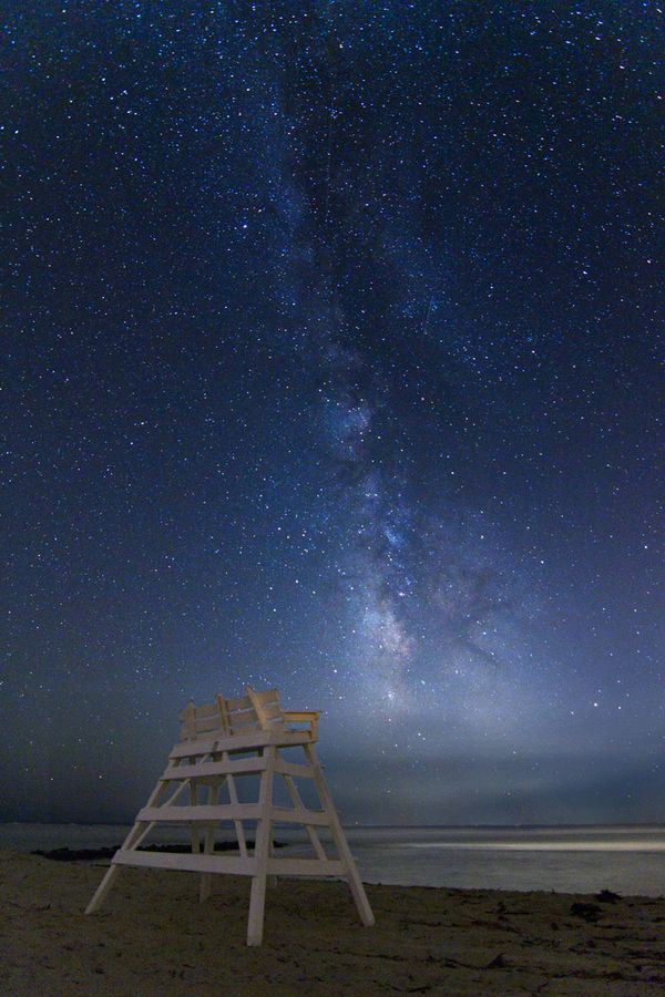 The Night Watch by Jack Fusco thk::::Cape May, New Jersey. A faint shooting stars streaks through the Milky Way as it reaches upward in front of a lifeguard stand on this Cape May, NJ beach.