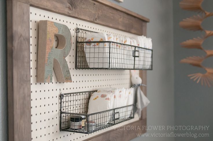My clients had this brilliant idea to use a peg board and these metal baskets for a diaper holder.  They made this themselves!!!  A pretty awesome DIY nursery project!!