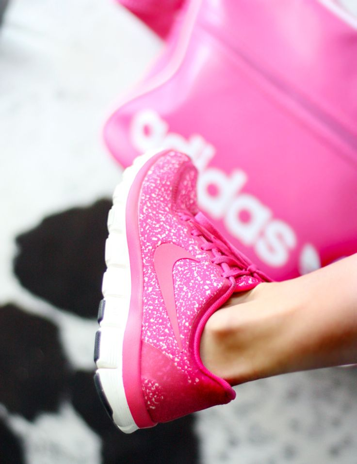 Hot pink glitter Nike shoes.