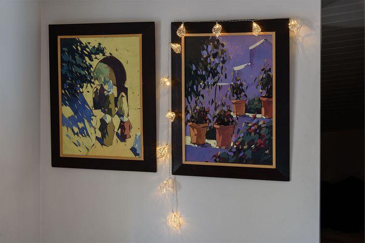Catena di foglie luminose per dare nuova luce e abbellire i dipinti alle pareti
