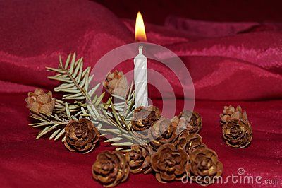 Christmas background - candle, fir cones and fir twig