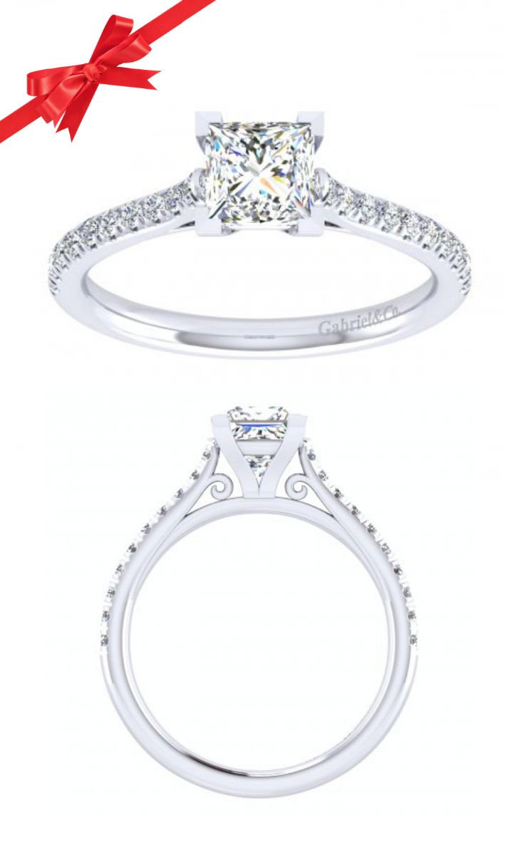 The most stunning non-traditional engagement ring from Gabriel. The princess cut is the centerpiece of this thin band. Is the center stone a natural yellow diamond or a champagne colored padparadscha sapphire? The choice is yours.
