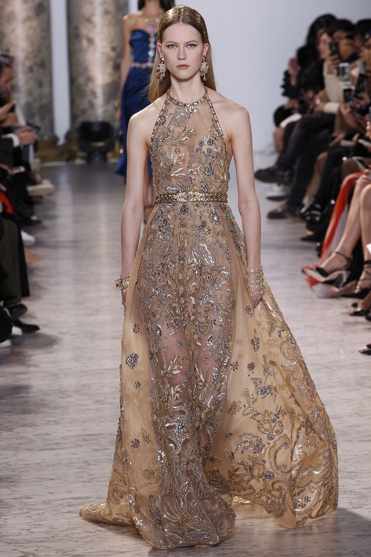 Elie Saab Spring 2017 Couture: Another gorgeous gold gown with intricate beading! I like the gold embellished belt!