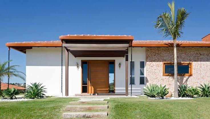 Residência Parque dos Manacás: Casas rústicas por Sorolla Mancini Arquitetura