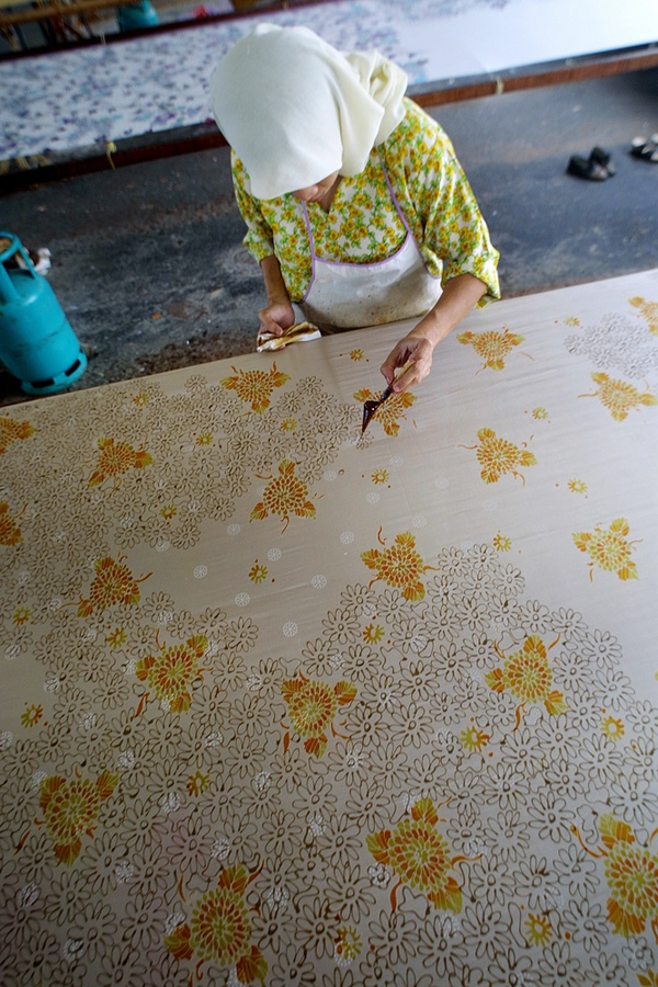 intricately detailed Indonesian batik pattern: wax has been used for centuries in the treatment of textiles