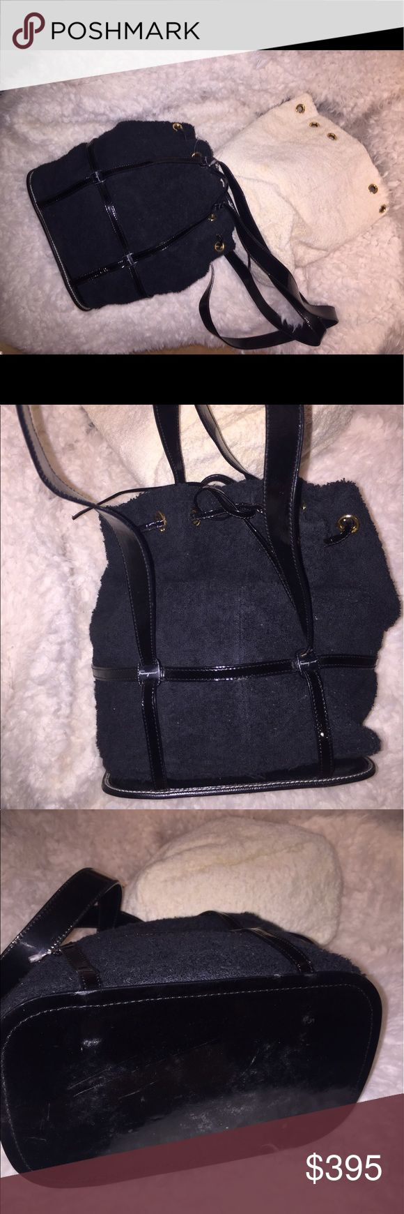 Ferragamo black & white towel material bag Used but in good condition. Comes with both black and white bags that can be interchanged. Can be worn in multiple ways including shoulder bag, bucket bag, and backpack. Ferragamo Bags