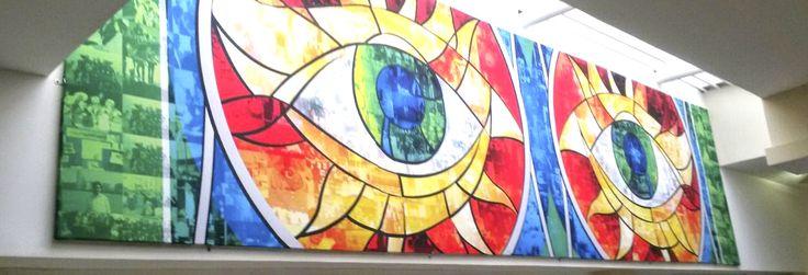 Mural tipo mosaico con fotografías en tela sublimada y bastidor. By Nómada Creativo