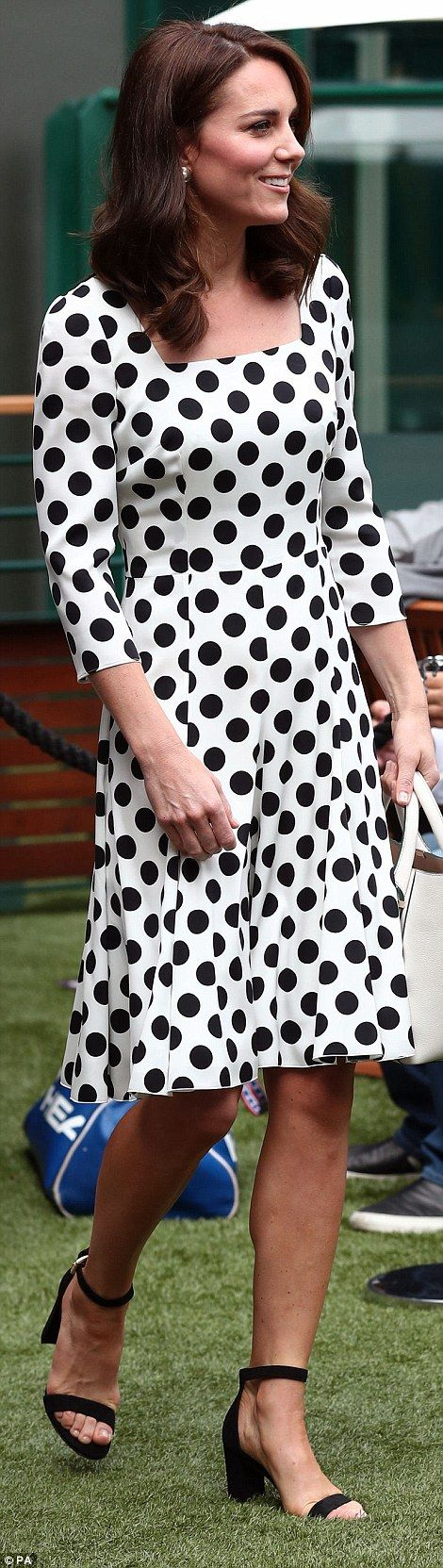 Today she opted for more fashion-forward strappy sandals to complement her polka dots