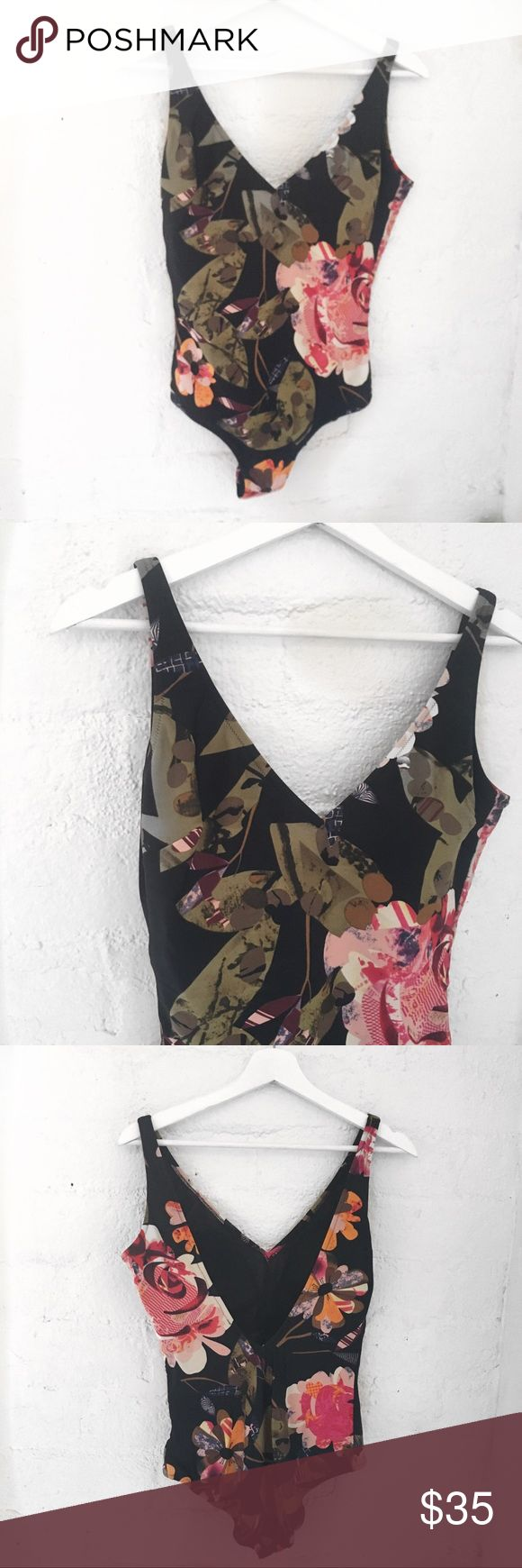 Gottex Silver One-Piece V-neck  Built in padding  Low v-back  Color: Black and red floral  82% Polyamide 18% Spandex   Size: 14   Condition: Like New, no damage   ▪️No Pets ▪️Non-smoking home  ▪️Ships from Los Angeles Gottex Silver Swim One Pieces