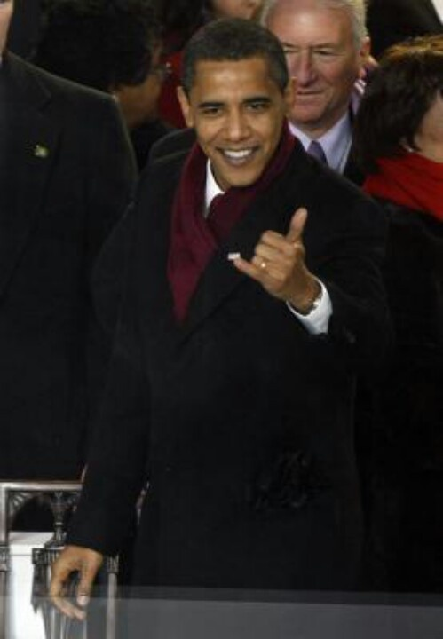 "The Commander-In-Chief gives the Hawaiian 'hang loose' sign. The gesture is usually coupled with the expression ""shaka, brah!"" A shaka sign -the unmistakable pinky and thumb salute - is the ultimate symbol of 'aloha' and local culture in Hawaii. Interpreted to mean ""hang loose"" or ""right on,"" the shaka is a constant reminder that in Hawaii, it is not the norm to worry or rush. The shaka represents the embodiment of 'island style,' signaling that everything is alright."