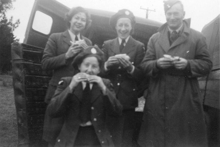 Three members of the Women's Auxiliary Air Force and an airman earing sandwiches, circa WWII. From the collection of the air Force Museum of New Zealand.