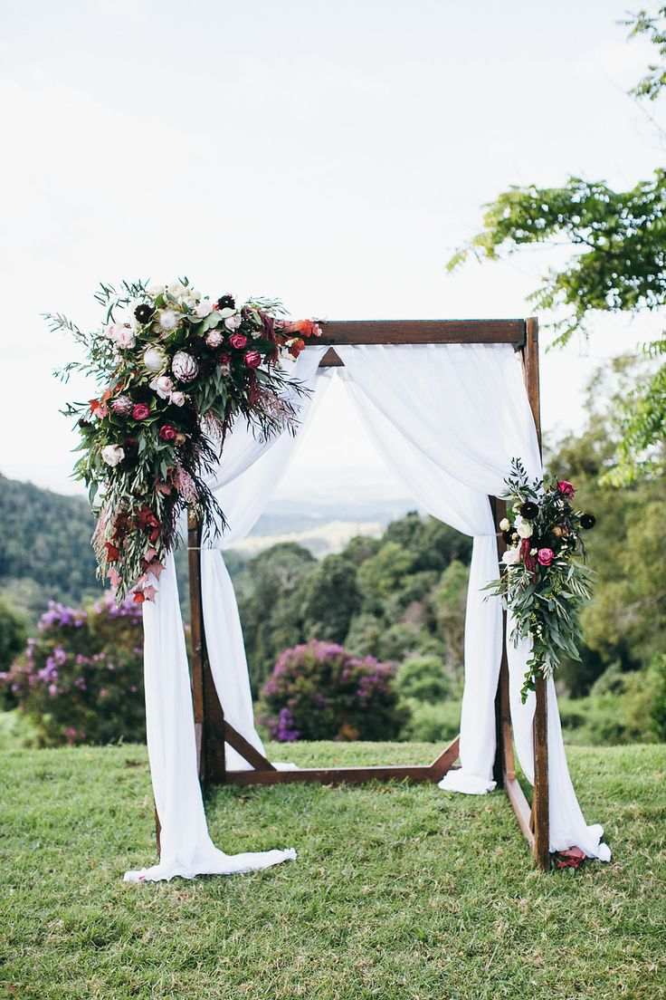 Native ceremony canopy feature with King Proteas and rustic foliages