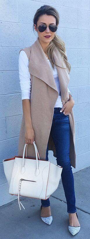 Camel vest over skinny jeans and white basic blouse. More inspo at www.closertofashion.com