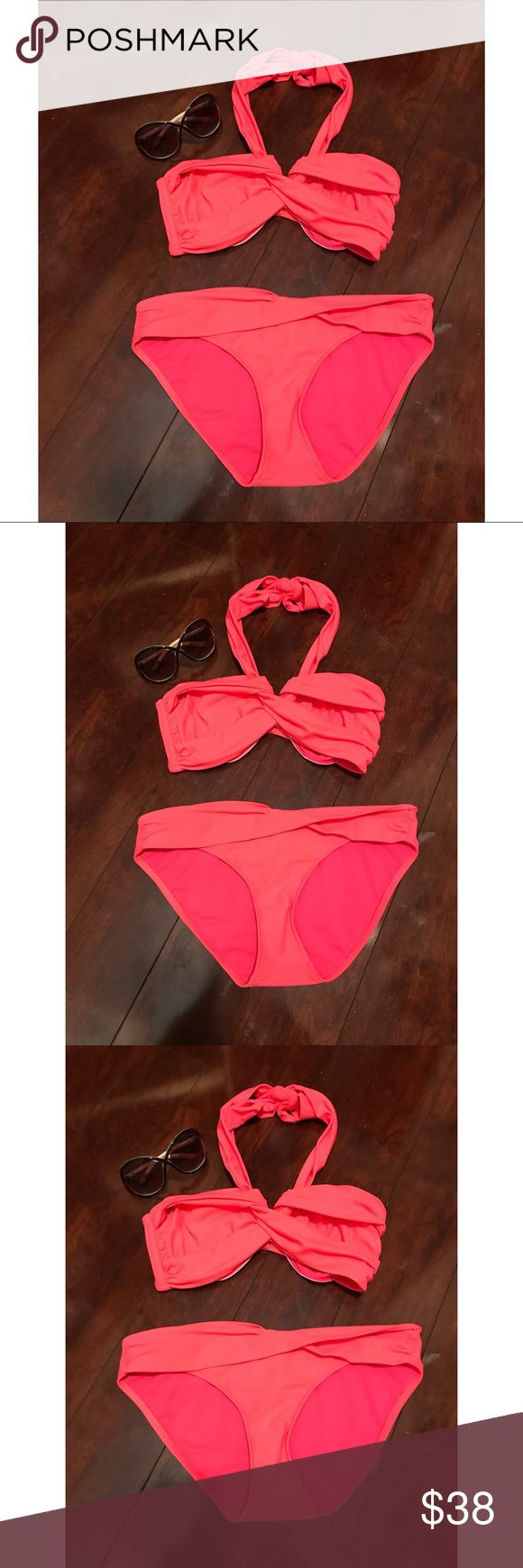 Hot Pink Seafolly Australia Bikini Hot pink bikini by seafolly , gently used . Bandeau criss cross top with halter tie.  It's the Goddess wrap . Perfectly compliments a nice tan , it's a size 14 (plus size) Seafolly Swim Bikinis