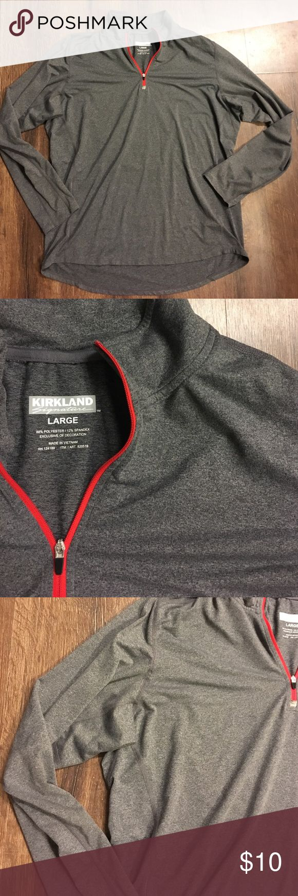 Mens gray athletic pull over, Kirkland Large Great condition, wore once. Red quarter zip, gray stretchy athletic material. Polyester and spandex. kirkland signature Shirts