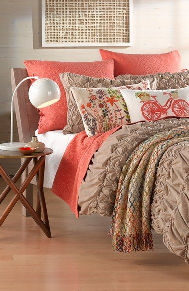 Love the coral accents on this bedding.
