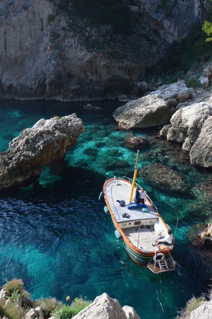 Gozzo caprese in emerald waters