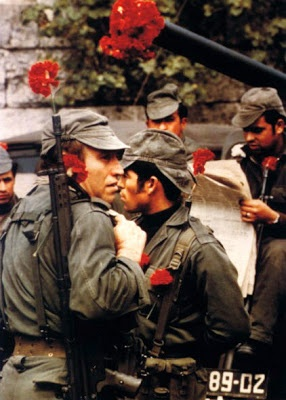 The Carnation Revolution - also referred to as the 25 April, was a military coup began on 25 April 1974, the day when we left a dictatorial regime, which lasted 41 years, behind. Although the regime's political police, PIDE, killed four people before surrendering, the revolution was unusual in that the revolutionaries did not use direct violence to achieve their goals. Holding red carnations, many people joined revolutionary soldiers on the streets.