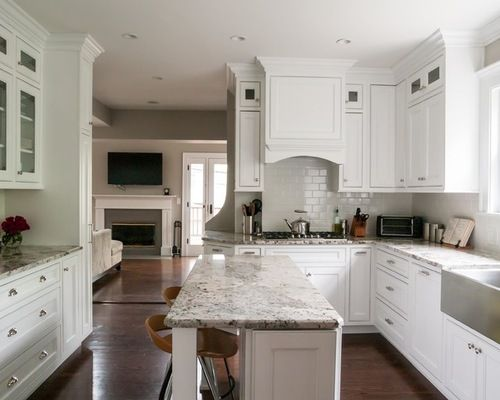 I think we will have to have a narrow island, but this one seems fine!  I like the granite color with the white cabinets.