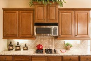 cupboard+above+microwave+taller | Microwaves set over the stove save space, but require a safe distance.