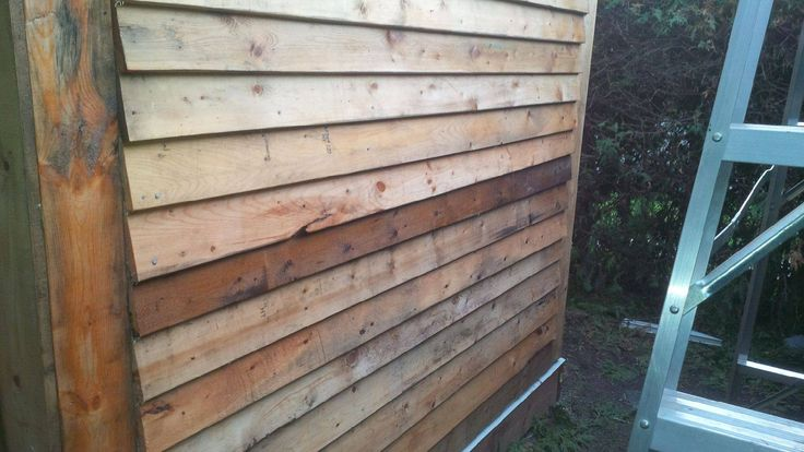 All exterior wood was reclaimed from old pallets.  Simply nailed on the OSB and frame and treated with Thomspon's Water Seal.  It is amazing the quality and character of some of  this wood.  Some pieces looked pretty bad, but once treated, were a standout!
