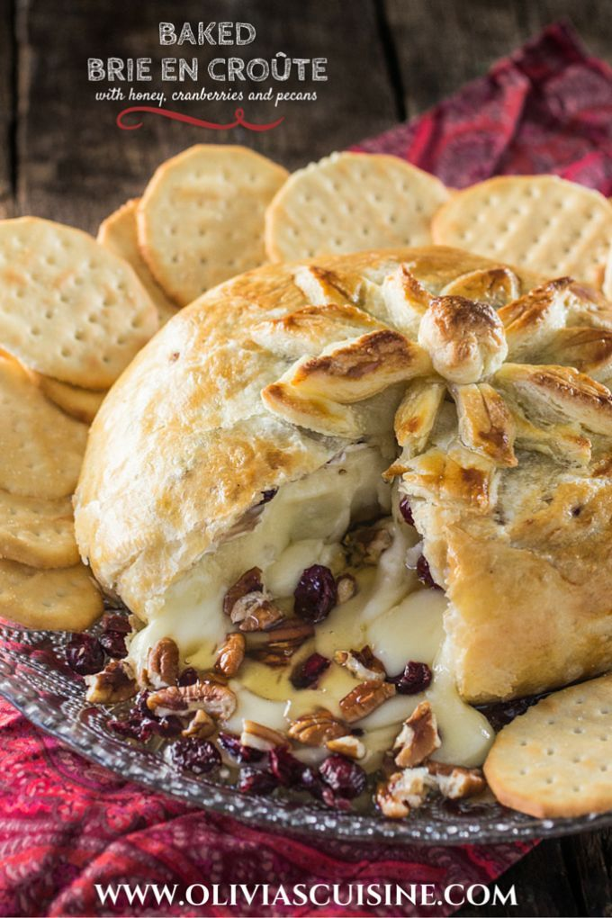 Baked Brie en Croute | http://www.oliviascuisine.com | A delicious brie cheese covered in puff pastry and filled with honey, cranberries and pecans. Perfect as a Thanksgiving or Christmas appetizer!
