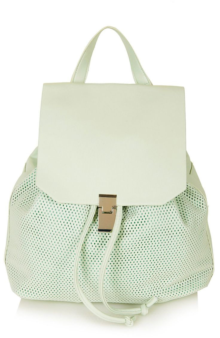 Can't get enough of this mint-green perforated Topshop backpack. It's so easy to wear, and turns every ensemble into an effortless and chic summer look.