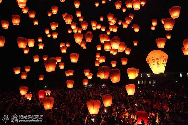 The sky lantern festival - Taiwan  http://www.flickr.com/photos/simonlan/5438744119/lightbox/