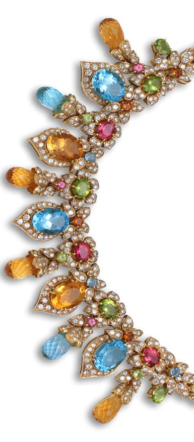 A diamond and gem-set necklace designed as a line of floral clusters with pavé-set round brilliant-cut diamond leaves each centering a peridot, pink tourmaline, citrine, or blue topaz, suspending a fringe of round brilliant-cut diamonds, oval and briolette citrine and blue topaz.