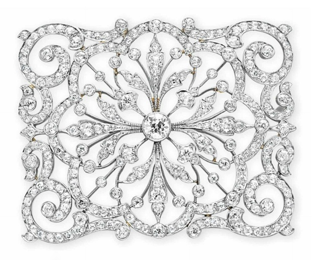 A BELLE EPOQUE DIAMOND BROOCH Designed as an old European-cut diamond oepnwork rectangular-shaped plaque of scrolling motif, mounted in platinum and gold, circa 1910