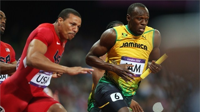 Usain Bolt of Jamaica receives the relay baton from Yohan Blake of Jamaica next to Ryan Bailey of the United States during the Men's 4 x 100m Relay Final on Day 15 of the London 2012 Olympic Games at Olympic Stadium.