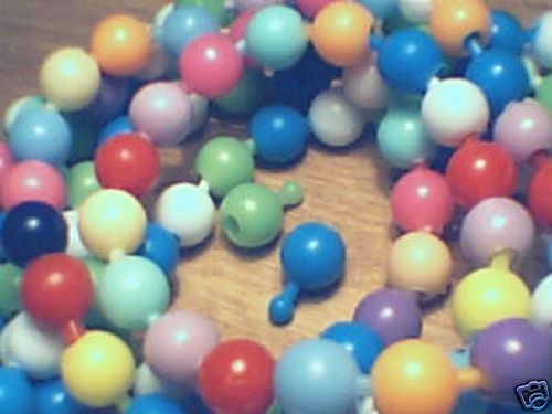 Pop Beads, just ordered some on ebay for my daughter's birthday party. They didn't stick together like the ones in my days.