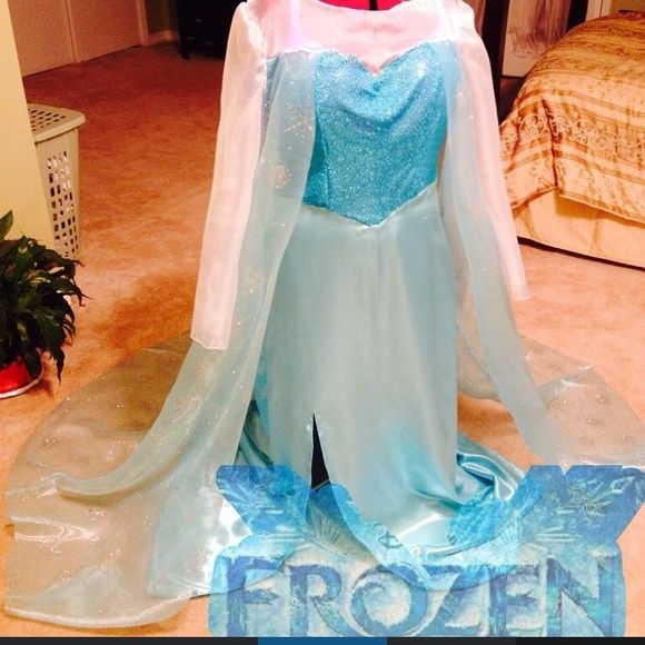 "Frozen Inspired Elsa Costume ❄️ ⛄️Do you wanna build a snowman? ❄️ Deluxe costume with rhinestones on the sheer sleeves and an extra long cape. Worn twice and many little girls stopped me thinking I was the REAL Elsa. Wig is included. I also have a 2T-4T Olaf costume so you can do ""Mommy n me"" for Halloween. Made by Me Other"