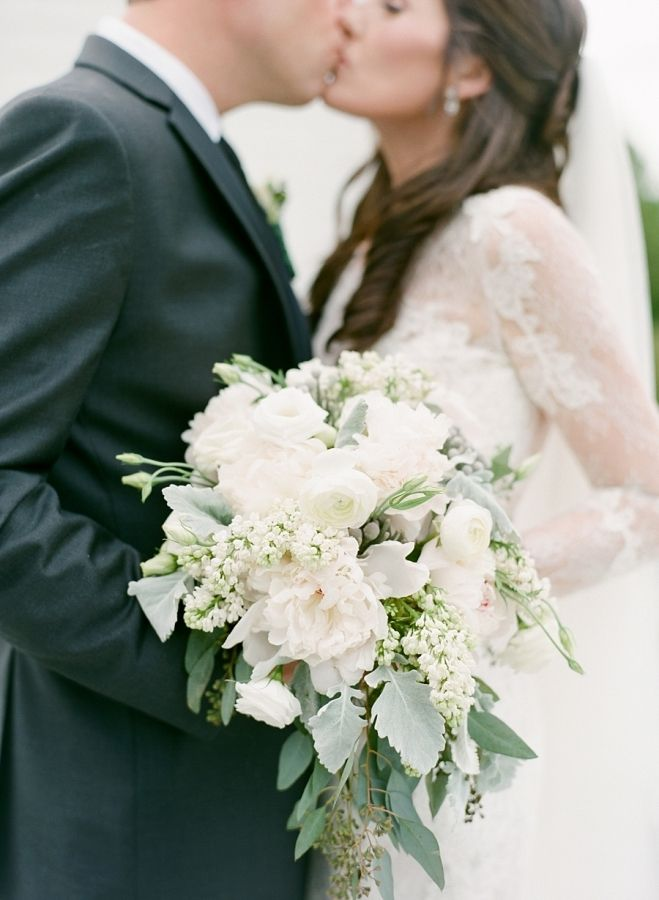 Soft classy ivory rose, peony, eucalyptus, and dusty miller wedding bouquet: http://www.stylemepretty.com/little-black-book-blog/2016/09/23/elegant-ivory-sage-long-island-wedding/ Photography: Elena Wolfe - http://elenawolfe.com/