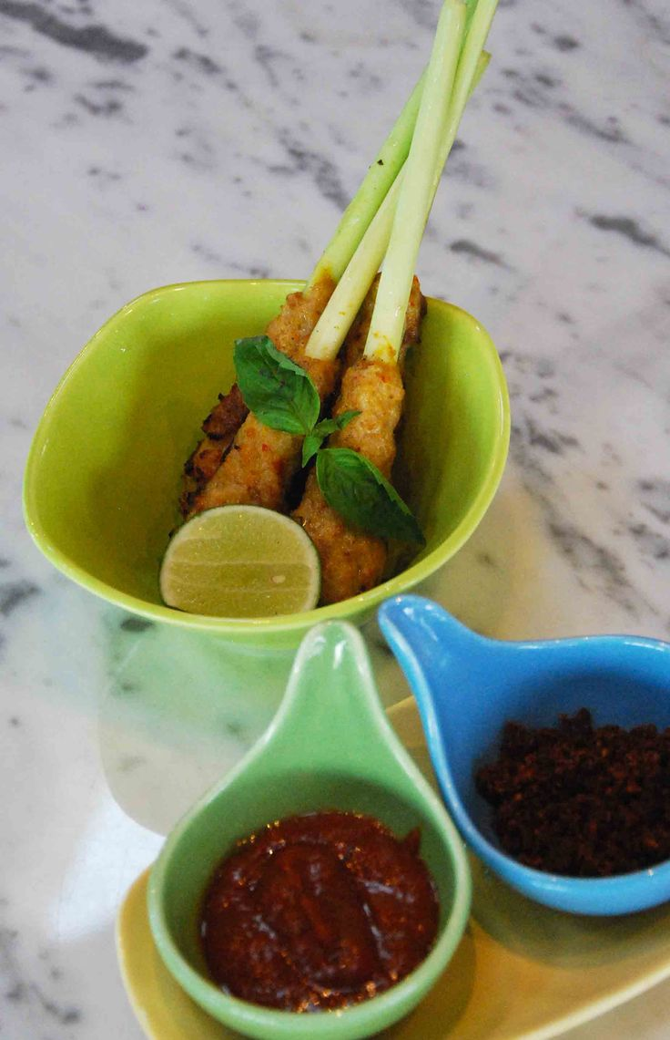 """Sate Lilit"" Balinese minced seafood satay with sambal ulek and sambal kering as the condiments"