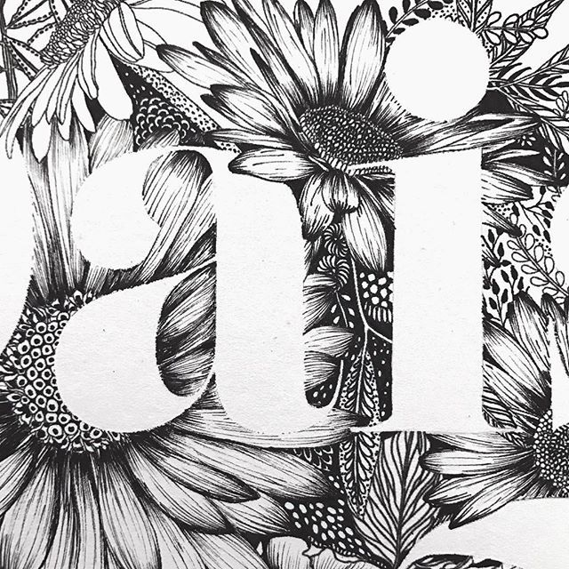 Closeup on serif lettering illustration surrounded by daisies. #monogram #lettering #typography