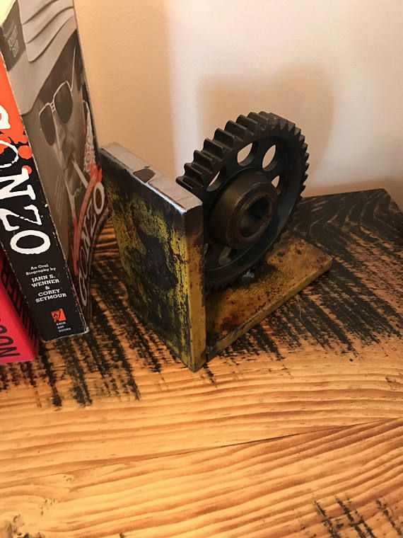 Pair of industrial bookends handmade with scrap steel and gears. Price is for the pair. 5.5 tall/long by 3 wide. Nice and heavy to hold books well. Fully clear coated to hold and protect the nice natural patina on these. FREE SHIPPING IN THE CON. U.S!! Please contact me with any