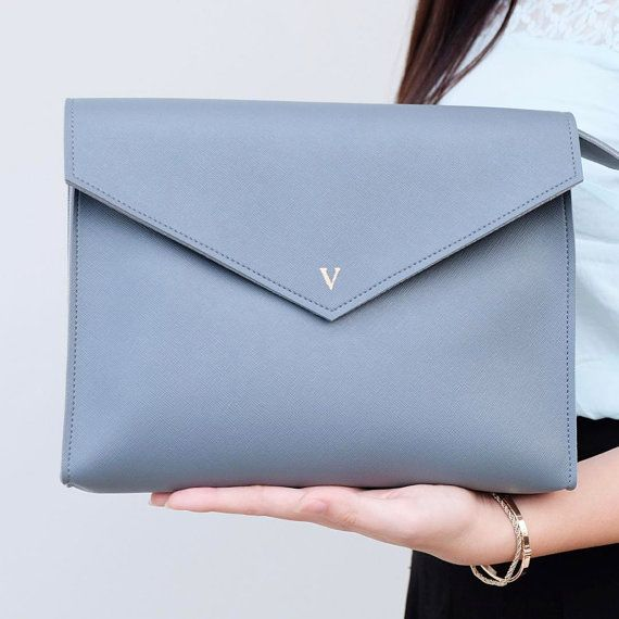 NEW ITEM!  Envelope Synthetic Saffiano PU Leather Clutch! Cute and functional at the same time. And better yet, you can personalize each of them with your name or initial. Perfect for chrismas gift, bridesmaids, birthday present, and mothers day gift!  - 27 x 20 x 4 cm (10.6 x 7.8 x 1.56 inch) - Zipper and magnetic button closure. - Gold foil monogramming : 3 letters (max) - Available color: grey, brown, blue, red, black, green, yellow, pastel blue, pink, pastel pink   Additional cost USD…
