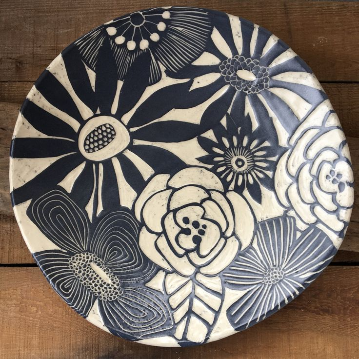 Made to order Made with a mid range stoneware clay body for durability. Each is uniquely hand crafted and designed. The glaze is smooth and soft to the touch. Food and dishwasher safe Dimentions: 13 round