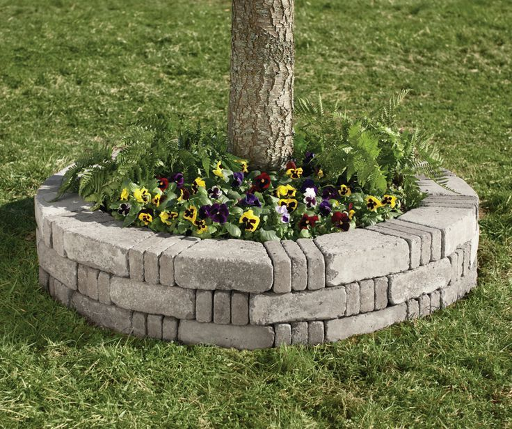 rumblestones make it easy to build a raised planting bed around a tree add pansies snapdragons or mums for bright fall color to complement the falling - Flower Garden Ideas Around Tree