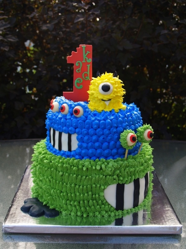 Monster 1st Birthday by ColeAlayne on Cake Central; like the different colors/monsters on different layers